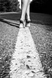 Young female legs walking Stock Images