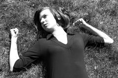 Young female lieing at the grass Stock Photos