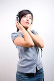 Young female listening music royalty free stock photography