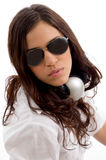 Young female listening music on headset Royalty Free Stock Photos