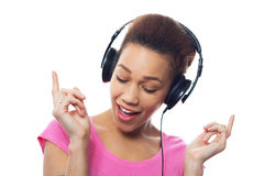 Young female listening to music Stock Images