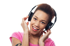 Young female listening to music Stock Photography