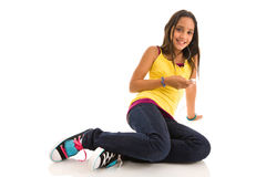 Young female listening to music on MP3 player Stock Images
