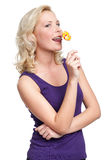 Young female with lollypop Stock Images