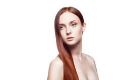 Young female with long straight natural red hair. Horizontal studio beauty portrait of young attractive green-eyed caucasian female with long straight natural royalty free stock photography