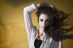 Young female with long windy hair Royalty Free Stock Image