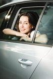 Young female looking out the car window Royalty Free Stock Photography