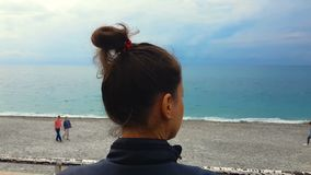 Young female looking sadly at people on seashore beach, depression, freedom. Stock footage stock video footage