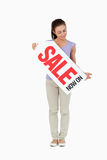 Young female looking at sales sign in her hands Royalty Free Stock Photo