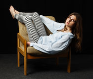 Young female lying in the armchair Stock Photos