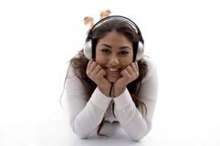 Young female lying and enjoying music Stock Photo