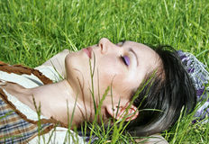Young female lying on the grass Royalty Free Stock Photo