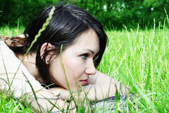 Young female lying on the grass Royalty Free Stock Image