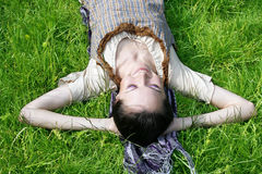 Young female lying on the grass Stock Image
