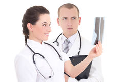 Young female and male doctors with xray isolated on white Royalty Free Stock Photography