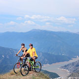 Young female and male posing with a mountain bikes Stock Images