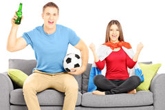 Young female and male sport supporters cheering Stock Image