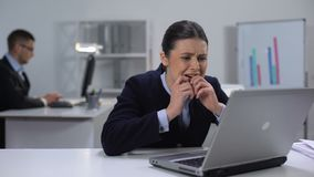 Young female manager texting message, sending incorrect e-mail, work mistake. Stock footage stock video footage
