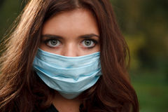 Young female in mask Stock Image