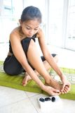 Young female massaging her own foot, Stock Photos