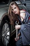 Young female mechanic. A young female mechanic fixing a car Royalty Free Stock Photo