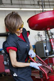 Young female mechanic working on welding equipment Stock Photo