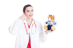 Young female medic with teddy bear Royalty Free Stock Photos