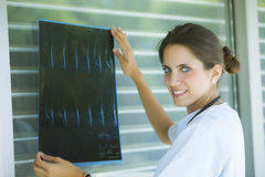 Young female medical doctor. Happy young female medical doctor Royalty Free Stock Photo