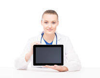 Young female medical worker with an ipad Royalty Free Stock Photography