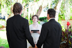 Young Female Minister Marries Gay Couple Stock Images