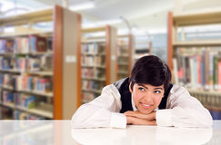 Young Mixed Race Student Daydreaming In Library Looking Up royalty free stock photography