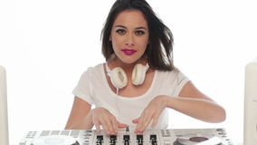 Young Female Mixing Music Using DJ Mixer stock footage