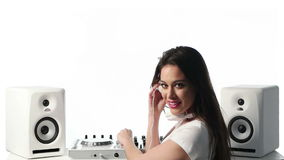 Young Female Mixing Music Using DJ Mixer stock video footage