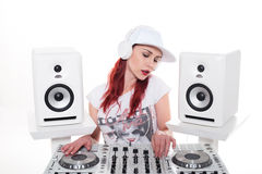 Young Female Mixing Music Using DJ Mixer Stock Photo
