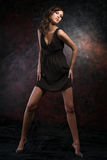 Young female model. In a black dress Royalty Free Stock Photography