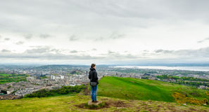 Young female model admiring Edinburgh landscape from the top of Royalty Free Stock Photo