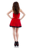 Young female model posing in red mini dress Stock Image