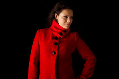 Young female model posing for winter coats catalog Royalty Free Stock Images