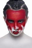 Young female model with red lips and blood on face Royalty Free Stock Photo