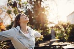 Woman at park enjoying fresh air Royalty Free Stock Images