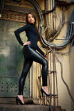 Young female model standing before rusty door Royalty Free Stock Photos