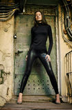 Young female model standing before rusty door royalty free stock photo