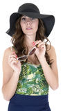 Young female model in swimsuit sunglasses and hat Royalty Free Stock Photo