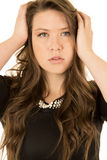 Young female model wearing a black dress with an intense look Royalty Free Stock Photography