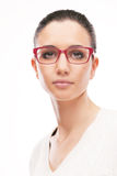 Young female model wearing fashion glasses Royalty Free Stock Image