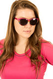 Young female model wearing pink top and sunglasses Royalty Free Stock Photo