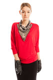 Young female model wearing red blouse with many accessories Royalty Free Stock Photo