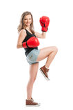 Young female model wearing red boxing gloves Royalty Free Stock Image