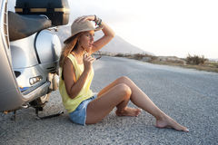 Young female on motorcycle trip Stock Photography