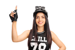 Young female motorcyclist pointing up Royalty Free Stock Photo